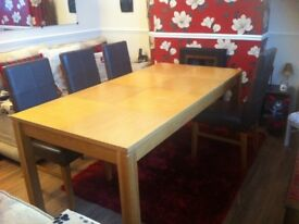 Light oak veneered dining table and 6 chairs