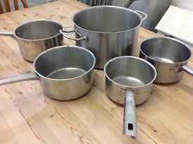 Set of stainles steel cooking pots heaven duty base.