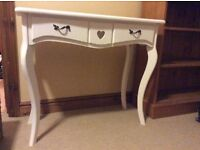 Matt White painted small dressing table with two drawers & central heart shaped cut out design