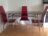 Black Glass Table with faux Red leather chairs x 4 delivered