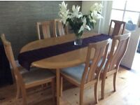 Light oak dining table and 6 chairs