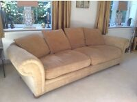 Large comfy sofa, gold coloured chenille 2500mm x 950mm, comes apart in the middle to move