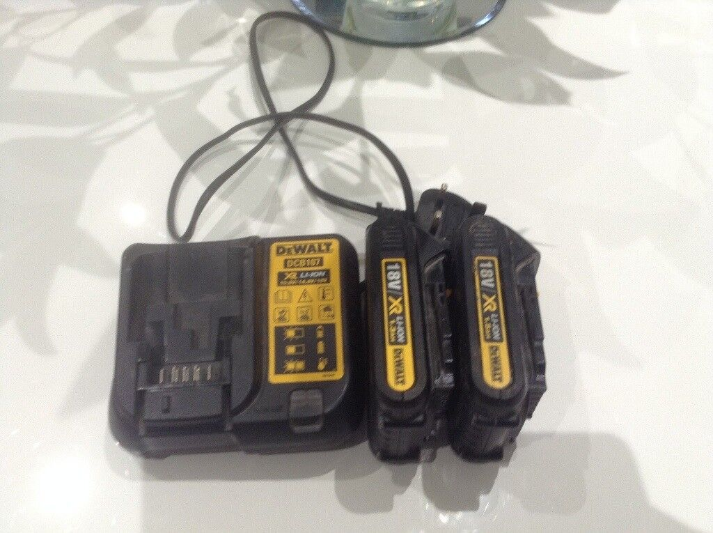 DEWALT BATTERY CHARGER AND TWO BATTERIES