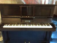 Upright piano free to good home. Interested parties must uplift.