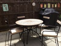Marks & Spencer's black metal / tiled patio table plus 4 chairs