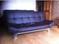 leather sofa bed, with adjustable arms, going cheap