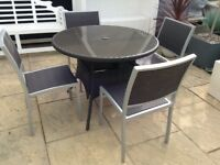 Quality rattan garden patio/conservatory circular table and 4 chairs £75 Ono tel 07966921804