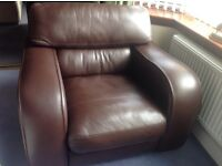 Large exceptionally comfy brown leather chair in great condition.