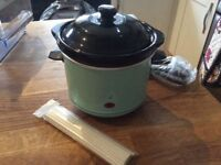 Unused chocolate fondue maker and sticks