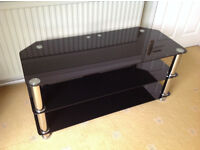 Beautiful as new example of Black glass and Chrome TV stand to fit up to 55'' screen