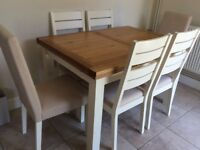 Extending dining table and 6 chairs for sale