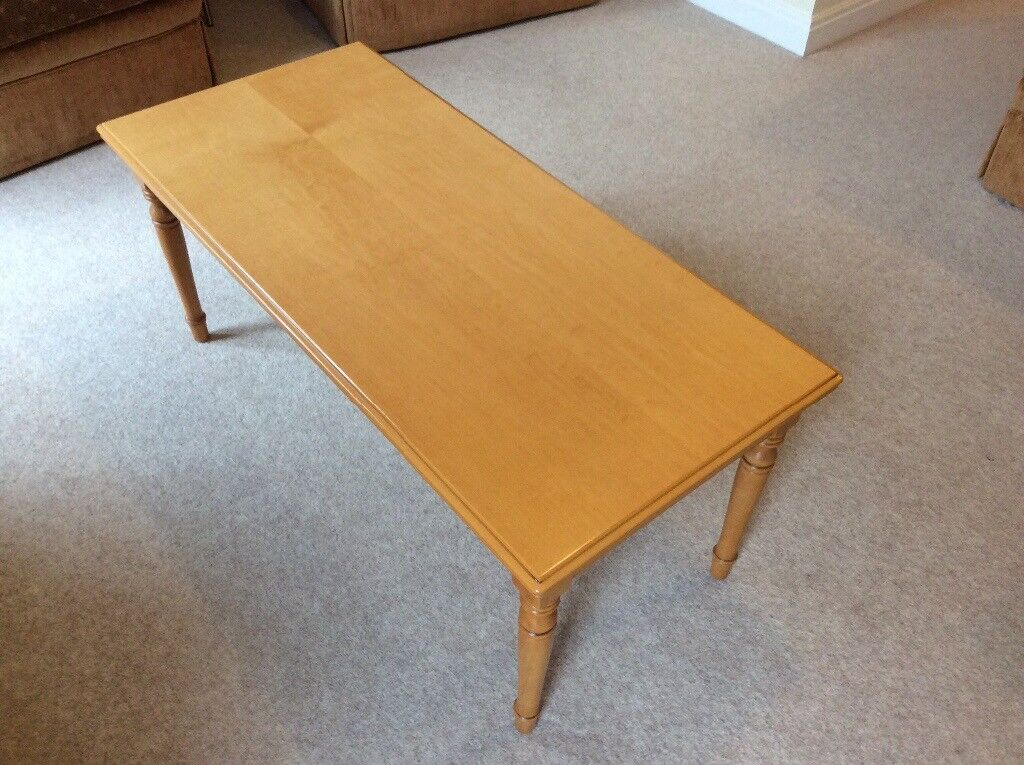 Light coloured wooden coffee table in good condition