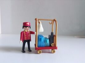 Complete Playmobil summer fun hotel porter with baggage cart (second hand).