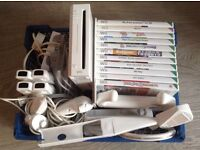 Nintendo wii console 4 controllers 4 nunchucks 11 games sports accessory pack and docking station