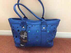 Lovely new blue ladies handbag.