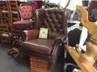 Brown leather Chesterfield queen Ann chair