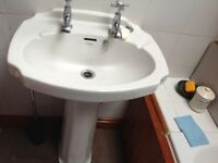 A superb bathroom pedestal basin with Art Deco taps