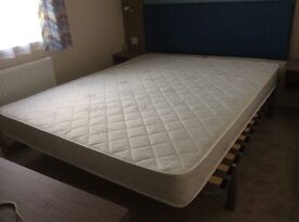King Size metal framed bed and sprung mattress. Excellent condition hardly used. Slatted bed frame.