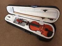3/4 size student violin with case.