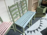 Cute blue and green garden bench for two