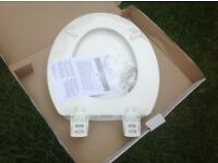 Brand New white 'StaTite' toilet seat - moulded wood