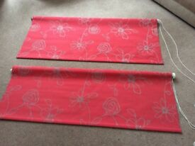 Matching pair of red roller blinds. Bright red with clematis design in grey.