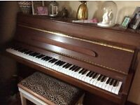 Lovely piano for sale.