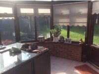 Used brown wood effect UPVC Conservatory for sale