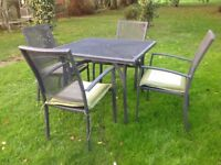 Metal garden table, chairs and cushions