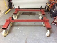 PAIR OF GARAGE WORKSHOP CAR TROLLEYS. MOVABLE WITH WHEELS.