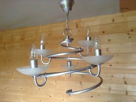 Silver 5 light ceiling light with white speckled glass bulb bases.