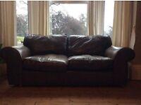 Brown Laura Ashley leather sofa