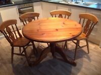 Solid pine pedestal table with four matching chairs
