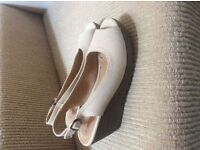 New and unworn size 4 cream wedges