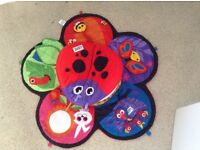Tummy spin toy with play mat