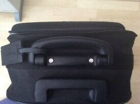 Black small/medium size trolley suitcase with 2 wheels and extending handle