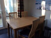 Solid wooden kitchen dining table and four chairs