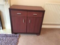 Dark wood storage cabinet with drawers