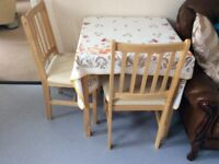 Kendall table and 2 chairs with cream seats from Argos
