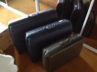 Three Samsonite suitcases