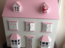 DOLLS HOUSE IN NEW CONDITION. with Furniture