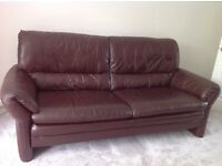 Brown leather sofas and storage foot stool
