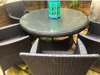 Polyrattan table with glass top and four chairs