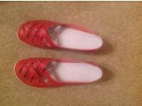 New red leather ladies shoes. Size 5