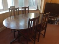 Dining table and four elegant barley twist oak chairs