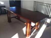 Dining table in antique pine finish.