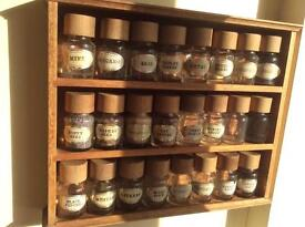 Wooden spice rack with 24 labelled jars