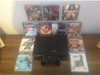 PS3 slim with 11 games controller ect