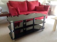 Two shelved black glass tv stand.