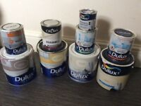 Selection of tins of Dulux paint for small paint jobs in the home (used)
